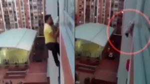 Il prend le risque pour sauver un chien qui risque de tomber d'un balcon