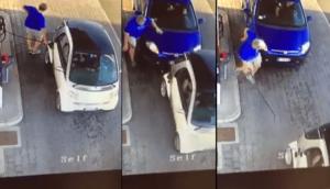 Une femme oublie de freiner à la pompe à essence