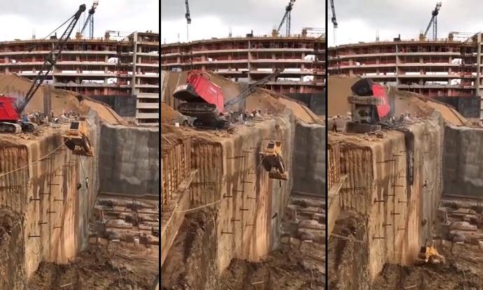 Ces ouvriers remontent un bulldozer avec une grue mobile. Grosse erreur !