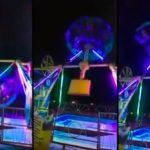 Une femme chute d'un manège en mouvement dans un parc d'attractions