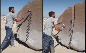 Il coupe un énorme rocher en deux avec grande précision